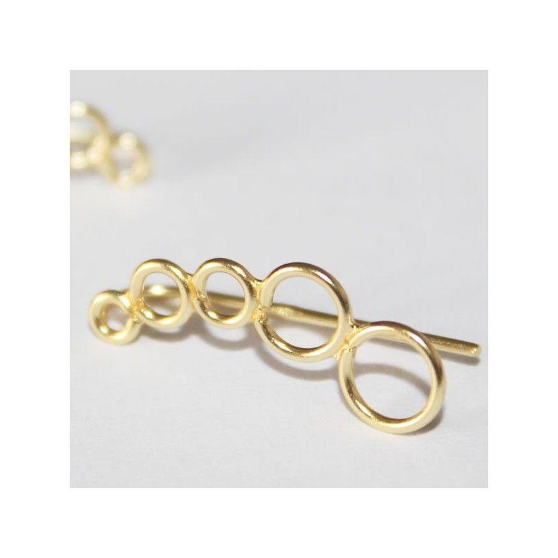 Pendientes trepadores de plata dorada con circulos